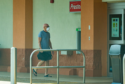 A shopper wearing a mask against the coronavirus heads into Publix at the Belmart Plaza on Belvedere Road in West Palm Beach on Tuesday, April 7, 2020. [JOSEPH FORZANO/palmbeachpost.com]