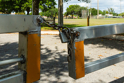 The gates to Westgate Park and Recreation Center on Oswego Avenue in West Palm Beach are locked and the park is empty on Tuesday, April 7, 2020. [JOSEPH FORZANO/palmbeachpost.com]