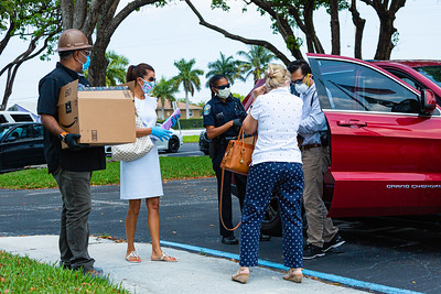 (From left to right) Sanjay Nayee from Amrit, Meike MacGregor, board member of the Singer Island Civic Association (SICA), Officer Cherise Phillips of the Riviera Beach Police Department, Marie Davis, Vice President of SICA and Raj Solanki of Amrit prepare to deliver PPE equipment to Riviera Beach Fire Station #87 in Riviera Beach on Wednesday, April 8, 2020. [JOSEPH FORZANO/palmbeachpost.com]