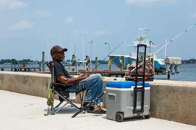 Gregory Benton of Lake Worth is enjoying the afternoon fishing along the seawall on S. Flagler Drive in West Palm Beach, Friday, April 10, 2020. [JOSEPH FORZANO/palmbeachpost.com]