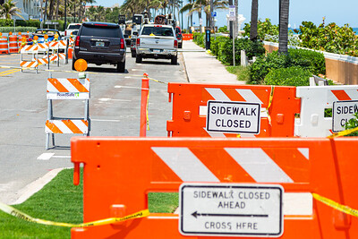 The sidewalk and northbound lanes on South Ocean Blvd., at Midtown Beach are fenced off for construction, April 21, 2020. Pedestrians have to cross S. Ocean Blvd at Worth Ave. to continue walking north. [JOSEPH FORZANO/palmbeachpost.com]