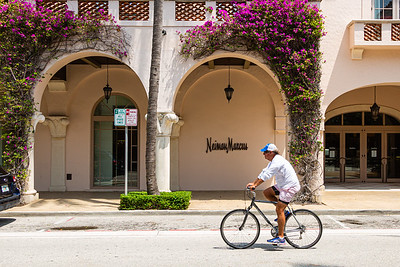 A cyclist rides past Neiman Marcus on Worth Avenue in Palm Beach, April 21, 2020. Neiman Marcus is expected to file for bankruptcy protection this week. [JOSEPH FORZANO/palmbeachdailynews.com]