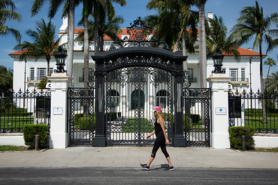 """Lisa Johnston of West Palm Beach begins her walk south along the Lake Trail in front of the closed Flagler Museum, Wednesday, April 22, 2020. """"I walk the Lake Trail all the time,"""" Johnston said. """"It's beautiful here."""" [JOSEPH FORZANO/palmbeachdailynews.com]"""