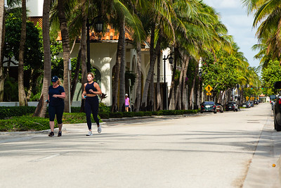 Two women jog east on Worth Avenue toward Midtown Beach in Palm Beach, April 23, 2020. Traffic on Worth Avenue is sparse, as all of the retail stores on Worth Avenue are closed due to the coronavirus pandemic. [JOSEPH FORZANO/palmbeachdailynews.com]