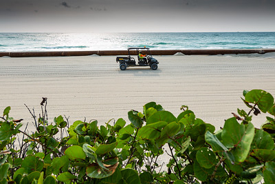 A worker drives a Carryall utility vehicle on the sands of Midtown Beach in Palm Beach, where a restoration project is currently underway, Friday, April 24, 2020. [JOSEPH FORZANO/palmbeachdailynews.com]