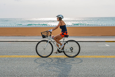 A woman rides her bike north on S. Ocean Blvd. in Palm Beach, Friday, April 24, 2020. [JOSEPH FORZANO/palmbeachdailynews.com]