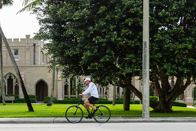 A man bikes on S. County Road past the Church of Bethesda-by-the-Sea, Friday, April 24, 2020. Bethesda-by-the-Sea has been closed due to the coronavirus pandemic. [JOSEPH FORZANO/palmbeachdailynews.com]