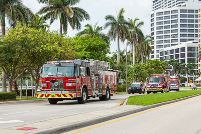 A procession of emergency vehicles heads north on S. Flagler Drive on their way to honor nurses and doctors at Good Samaritan and St Mary's hospitals in West Palm Beach, Friday, April 24, 2020. [JOSEPH FORZANO/palmbeachpost.com]