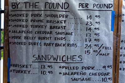 Part of the menu board at the Okeechobee Prime Meat Market roadside BBQ on Wabasso Drive in West Palm Beach, Tuesday, April 28, 2020. [JOSEPH FORZANO/palmbeachpost.com]