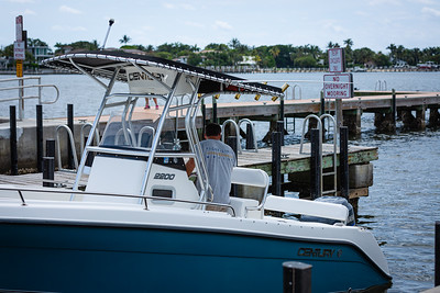 Jeremy Efron, owner of Tight Lines Marine, guides his boat down the ramp and into the water at Sportsman Park In Lantana, Wednesday, April 29, 2020.Boat launches have been closed for over a month due to coronavirus. [JOSEPH FORZANO/palmbeachpost.com]