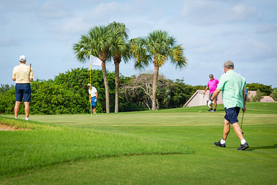 A foursome gathers on the green near the pin on the course at the Westchester Golf Club in Boynton Beach, Wednesday, April 29, 2020. Golf courses were open for business for the first time in weeks. [JOSEPH FORZANO/palmbeachpost.com]