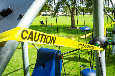 Caution tape wraps the playground equipment at Boynton Beach Park in Boynton Beach, Wednesday, April 29, 2020. A mom and her two children came to the park, expecting it to be open. [JOSEPH FORZANO/palmbeachpost.com]