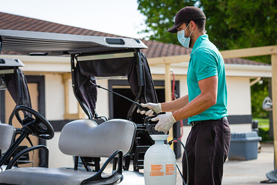 Scott Murphy sprays down a golf cart with disinfectant at the Westchester Golf Club in Boynton Beach, Wednesday, April 29, 2020. Golf courses were open for business for the first time in weeks. [JOSEPH FORZANO/palmbeachpost.com]