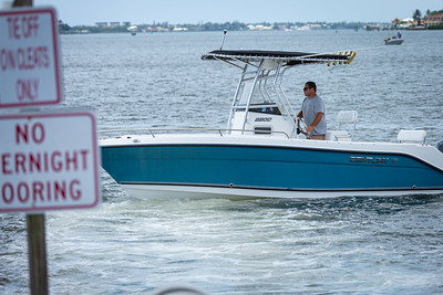 Jeremy Efron, owner of Tight Lines Marine, guides his boat out into the Intracoastal Waterway at Sportsman Park In Lantana, Wednesday, April 29, 2020.Boat launches have been closed for over a month due to coronavirus. [JOSEPH FORZANO/palmbeachpost.com]