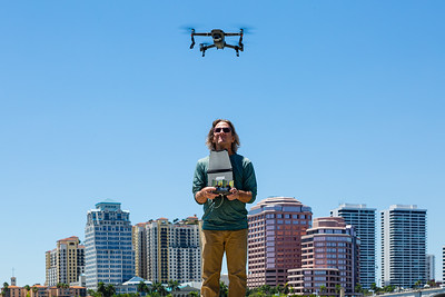 Greg Lovett, Palm Beach Post multimedia journalist and licensed drone pilot, flies his drone against a backdrop of the West Palm Beach skyline, Friday, May 1, 2020. [JOSEPH FORZANO/palmbeachpost.com]