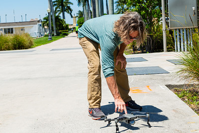 Greg Lovett, Palm Beach Post multimedia journalist and licensed drone pilot, powers on his drone near the Intracoastal Waterway in Palm Beach, Friday, May 1, 2020. [JOSEPH FORZANO/palmbeachpost.com]