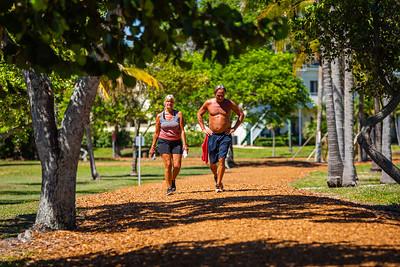 Marci Wall, left, and Thomas Kurucar of Jupiter walk the trails in Carlin Park, in Jupiter, Monday, May 4, 2020. [JOSEPH FORZANO/palmbeachpost.com]