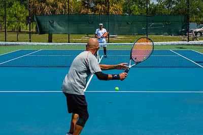 Willie Reynoso volleys against Pablo Rossi on the tennis courts at Okeeheelee Park in West Palm Beach, Wednesday, April 6, 2020. Palm Beach County started reopening parks on April 29, easing mandated coronavirus restrictions. [JOSEPH FORZANO/palmbeachpost.com]