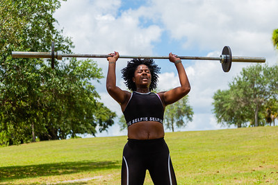 Kysha Saffron of Royal Palm Beach works out in Okeeheelee Park in West Palm Beach, Wednesday, April 6, 2020. Palm Beach County started reopening parks on April 29, easing mandated coronavirus restrictions. [JOSEPH FORZANO/palmbeachpost.com]