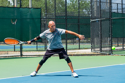 Willie Reynoso of West Palm Beach returns a serve on the tennis courts at Okeeheelee Park in West Palm Beach, Wednesday, April 6, 2020. Palm Beach County started reopening parks on April 29, easing mandated coronavirus restrictions. [JOSEPH FORZANO/palmbeachpost.com]