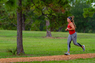 Caitlin Chandler of West Palm Beach jogs as part of her workout through Okeeheelee Park in West Palm Beach, Wednesday, April 6, 2020. Palm Beach County started reopening parks on April 29, easing mandated coronavirus restrictions. [JOSEPH FORZANO/palmbeachpost.com]