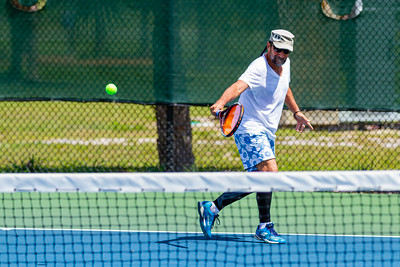Pablo Rossi of West Palm Beach returns a serve on the tennis courts at Okeeheelee Park in West Palm Beach, Wednesday, April 6, 2020. Palm Beach County started reopening parks on April 29, easing mandated coronavirus restrictions. [JOSEPH FORZANO/palmbeachpost.com]