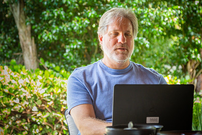 Joel Engelhardt, Investigative Team Editor at the Palm Beach Post, works from his backyard in Palm Beach Gardens, Saturday, May 9, 2020. Engelhardt, along with his colleagues from The Post, have been working remotely for two months since the outbreak of the coronavirus. [JOSEPH FORZANO/palmbeachpost.com]