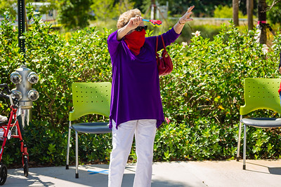 A resident of MorseLife wave to friends and family as the special Mother's Day Parade procession rolls by at MorseLife in West Palm Beach, Saturday, May 9, 2020. Residents at MorseLife have been in isolation since the outbreak of the coronavirus. [JOSEPH FORZANO/palmbeachpost.com]