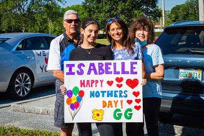 The Fertig family, Joe, Hallie Kaufman, Joyce and Naomi hold a sign for their mother before a special Mother's Day Parade at MorseLife in West Palm Beach, Saturday, May 9, 2020. Residents at MorseLife have been in isolation since the outbreak of the coronavirus. [JOSEPH FORZANO/palmbeachpost.com]