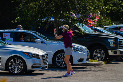 Stephanie Frazier, Executive Director at MorseLife directs cars to line up for the special Mother's Day Parade at MorseLife in West Palm Beach, Saturday, May 9, 2020. Residents at MorseLife have been in isolation since the outbreak of the coronavirus.  [JOSEPH FORZANO/palmbeachpost.com]