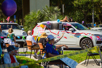 Residents of MorseLife wave to friends and family as the special Mother's Day Parade procession rolls by at MorseLife in West Palm Beach, Saturday, May 9, 2020. Residents at MorseLife have been in isolation since the outbreak of the coronavirus. [JOSEPH FORZANO/palmbeachpost.com]