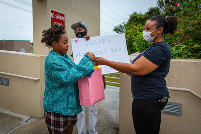 Kenria Woodson of Belle Glade, left, Tray Johns of the New Florida Majority, center, and Foxxy Manning, President of FedFam4Life, share a moment outside the Palm Beach County Jail on Gun Club Road in West Palm Beach, Sunday, May 10, 2020. Johns' organization raised the money to bail Woodson out of jail for Mother's Day. [JOSEPH FORZANO/palmbeachpost.com]