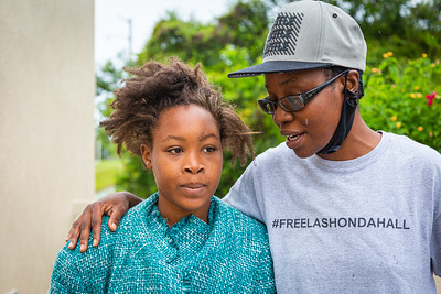 Kenria Woodson of Belle Glade, left, and Tray Johns of the New Florida Majority, outside the Palm Beach County Jail on Gun Club Road in West Palm Beach, Sunday, May 10, 2020. Johns' organization raised the money to bail Woodson out of jail for Mother's Day. [JOSEPH FORZANO/palmbeachpost.com]