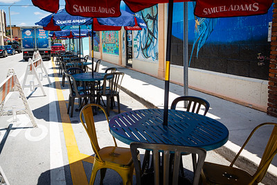 The City of Lake Worth Beach has allowed Dave's Last Resort and Raw Bar to place tables in the parking area on N. K Street to help with social distancing protocols during the coronavirus pandemic, Tuesday, May 12, 2020. [JOSEPH FORZANO/palmbeachpost.com]