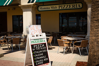Mama Mia's Pizza at Lake Worth Beach Park in Lake Worth Beach is open for business after being closed due to the coronavirus pandemic, Tuesday, May 12, 2020. Outdoor seating is available and social distancing protocols are being followed. [JOSEPH FORZANO/palmbeachpost.com]