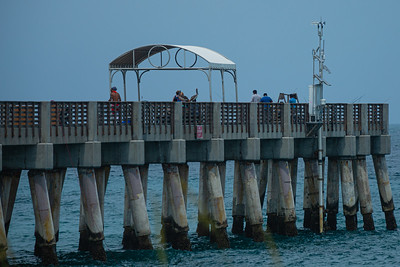A few people fish on pier on the William O. Lockhart Municipal Pier at Lake Worth Beach, Tuesday, May 26, 2020. [JOSEPH FORZANO/palmbeachpost.com]