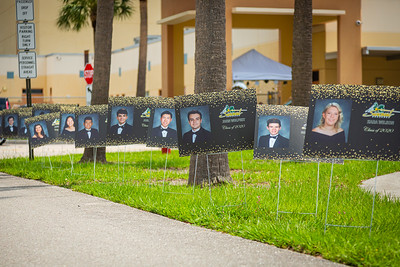 Over 900 photos of the Suncoast High School senior class line the entrance to the school in Riviera Beach, Wednesday, May 27, 2020. Suncoast High School gave out caps and gowns and other items along with the prized diplomas in a drive through fashion at the school. [JOSEPH FORZANO/palmbeachpost.com]