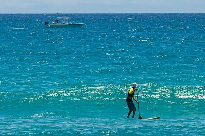 A paddle boarder rides the ocean current off of Juno Beach, Monday, June 15, 2020. [JOSEPH FORZANO/palmbeachpost.com]