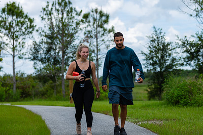 Brianna Fortuna, left, and Bayan Kaki of Wellington walk one of the trails at the Wellington Environmental Preserve in Wellington, Monday, June 22, 2020. [JOSEPH FORZANO/palmbeachpost.com]