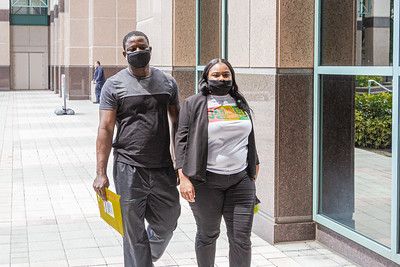 Late Gean of West Palm Beach, left, and Cassandra Jackson of Miami leave the Palm Beach County Courthouse in West Palm Beach, Wednesday, June 24, 2020. Palm Beach County commissioners unanimously agreed that masks must be worn in all buildings where the public is welcome to help fight the spread of coronavirus. [JOSEPH FORZANO/palmbeachpost.com]