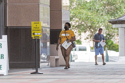 A woman wearing a face mask prepares to enter the Palm Beach County Courthouse in West Palm Beach, Wednesday, June 24, 2020. Palm Beach County commissioners unanimously agreed that masks must be worn in all buildings where the public is welcome to help fight the spread of coronavirus. [JOSEPH FORZANO/palmbeachpost.com]