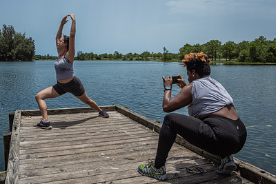 "Chiquita Carnegie, right, of Royal Palm Beach makes a photo of her friend Kara Schwarz of West Palm Beach, at Okeeheelee Park on Sunday, June 28, 2020. Carnegie and Schwarz took ""before"" photos of each other at the start of a friendly weight loss competition. [JOSEPH FORZANO/palmbeachpost.com]"