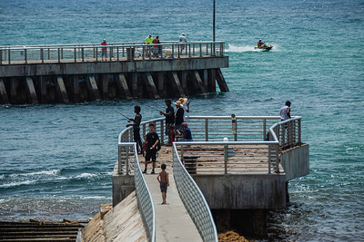 People fish from the north and south jetties at the Boynton Inlet in Boynton Beach, Sunday, June 28, 2020. [JOSEPH FORZANO/palmbeachpost.com]