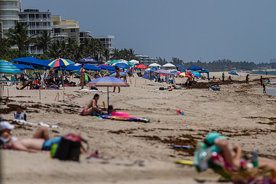 Beachgoers enjoy the sun on Lake Worth Beach, Monday, June 29, 2020. Due to the rise in coronavirus cases, Palm Beach County will close beaches Friday, July 3 to help fight the spread of the disease. [JOSEPH FORZANO/palmbeachpost.com]