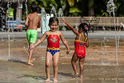 Kids play in the Fountain Plaza splash pad at Dreher Park Zoo in West Palm Beach, Tuesday, June 30, 2020. The zoo is operating at reduced capacity, and there is a one-way path designated throughout the zoo. [JOSEPH FORZANO/palmbeachpost.com]