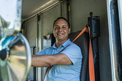 Rey Riviera, co-owner of TCS (Temperature Control Solutions) poses for a photo in his work van in Lake Worth on Wednesday, July 1, 2020. [JOSEPH FORZANO/palmbeachpost.com]