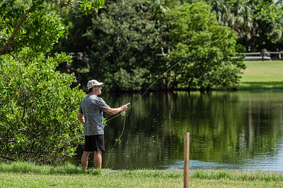 A man fly fishes in the lake at Carlin Park in Jupiter on a hot summer day, Tuesday, July 14, 2020. [JOSEPH FORZANO/palmbeachpost.com]