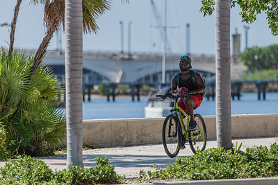 A man rides his bike along the waterfront in downtown West Palm Beach on Wednesday, July 15, 2020. [JOSEPH FORZANO/palmbeachpost.com]