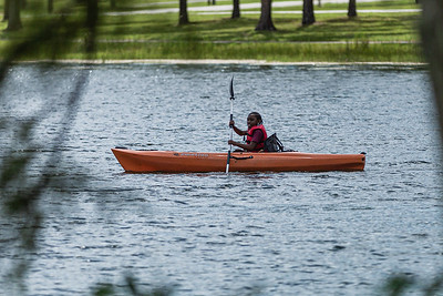 A girl paddles a kayak in the lake at Okeeheelee Park in West Palm Beach, Friday, July 17, 2020. [JOSEPH FORZANO/palmbeachpost.com]