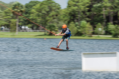 A boy jumps a ramp while wake boarding at Shark Wake Park in Okeeheelee Park in West Palm Beach, Friday, July 17, 2020. [JOSEPH FORZANO/palmbeachpost.com]